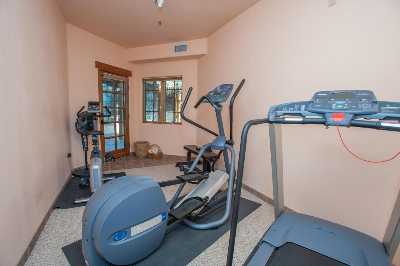 Fitness Room with treadmill, stationary bike, and elliptical machine
