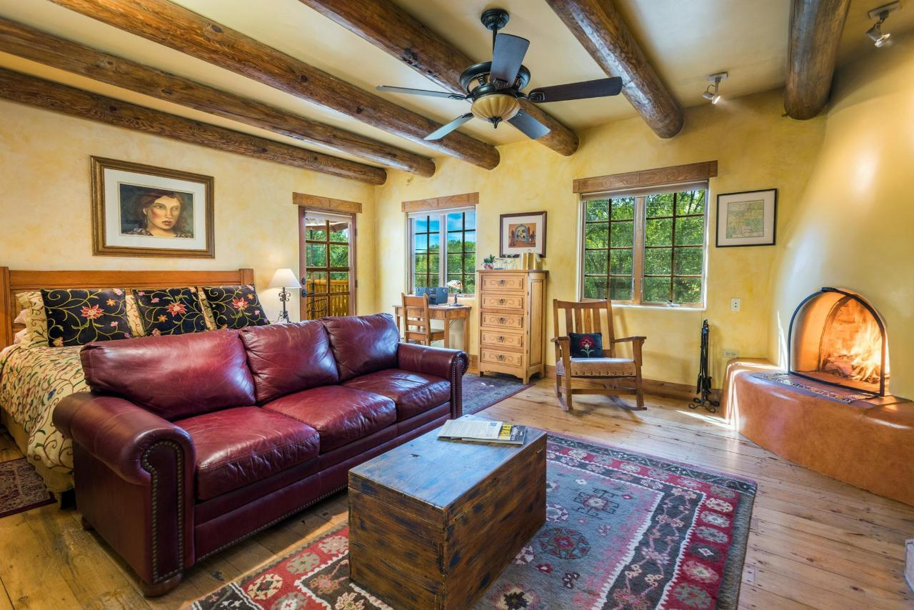 Spanish Colonial is a deluxe king room with private deck and kiva fireplace