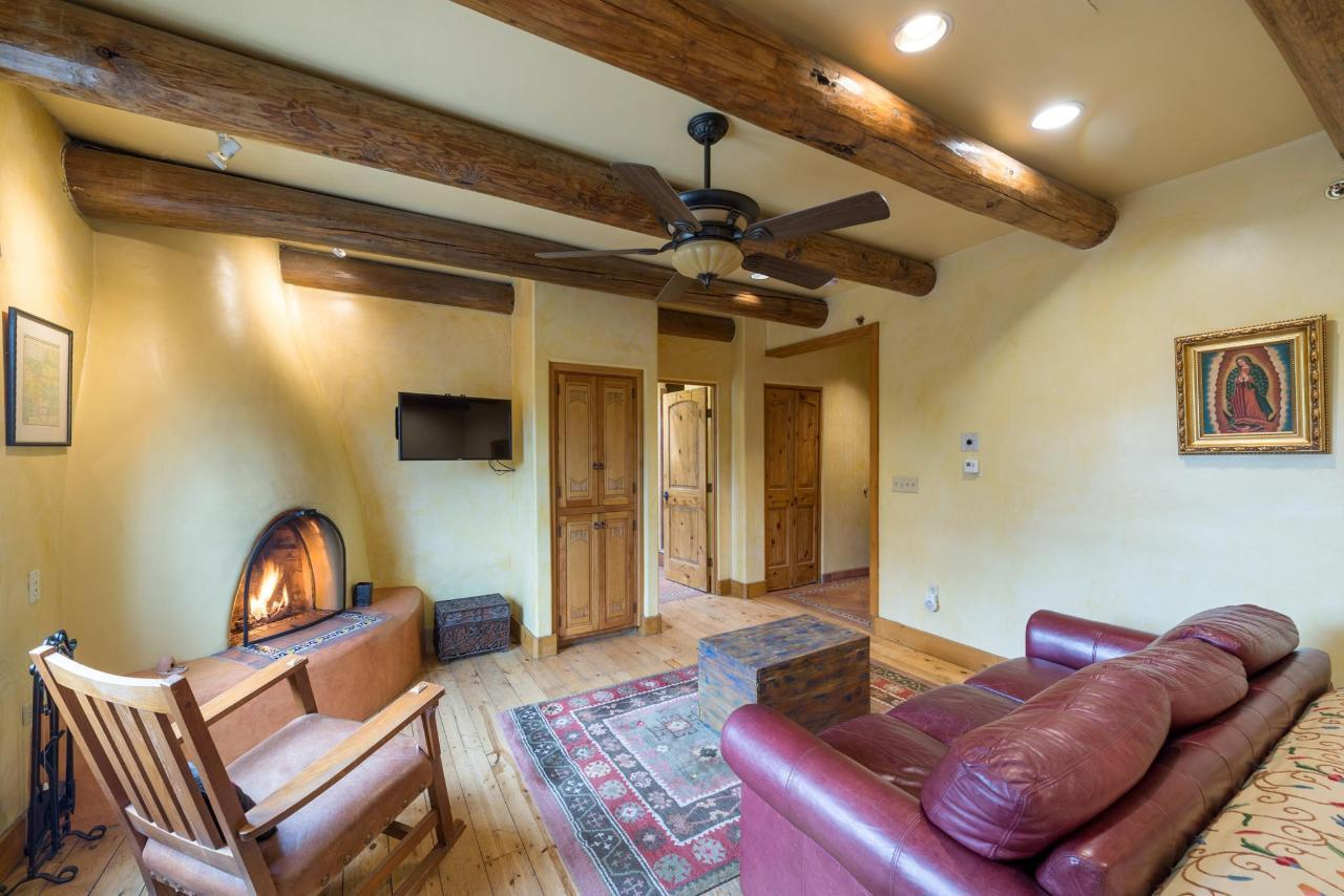 Spanish Colonial has a queen sleeper sofa and kiva fireplace