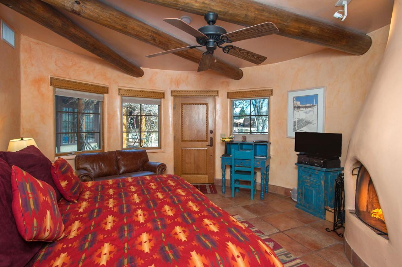 Taos Pueblo has a kiva fireplace, writing desk, and sofa