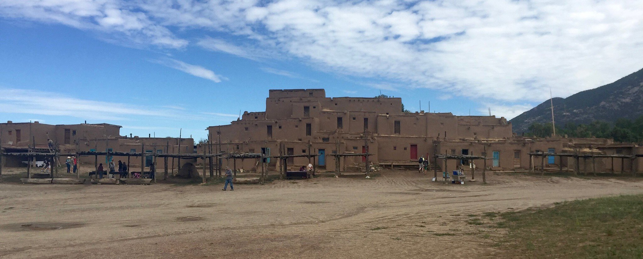 taos pueblo, Taos, NM buildings with sand and mountains